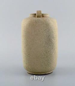 Arne Bang. Ceramic vase with square corpus with two small angled handles